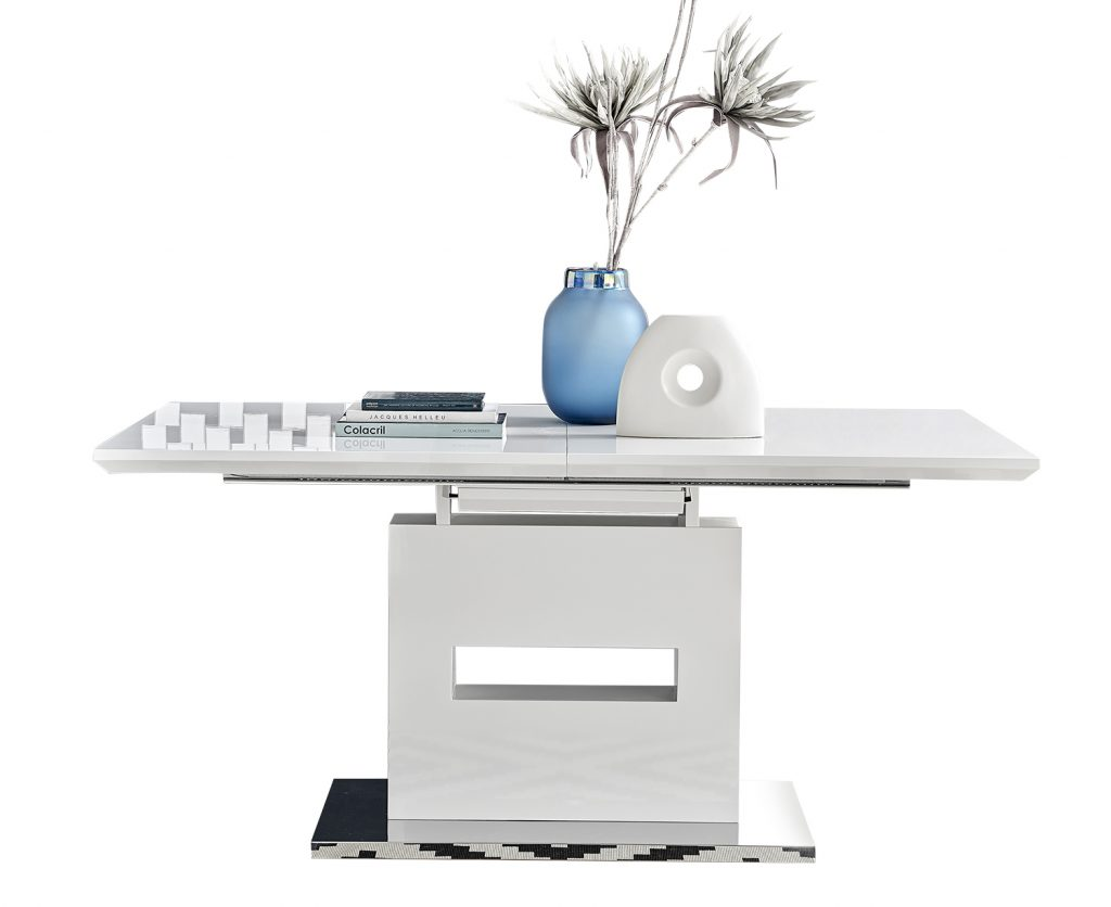 large white gloss extending dining table with large base and modern accessories on a white background