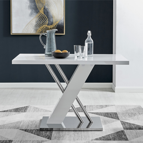 sorrento white gloss dining table with modern base design in a contemporary room