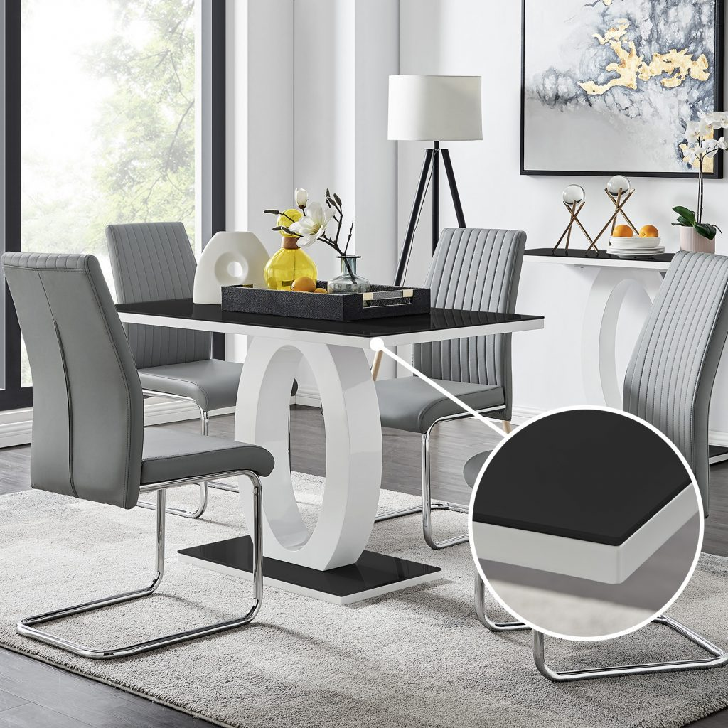 the Giovani contemporary dining table with 4 grey dining chairs in a modern dining room