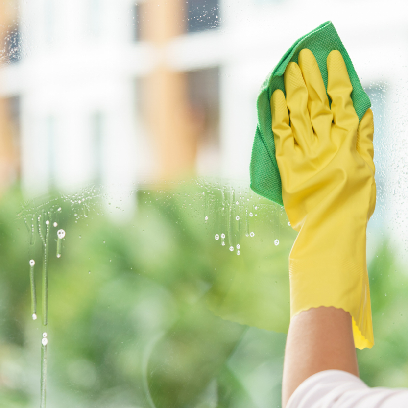 Cleaning a window. clean windows to prepare your home for sale