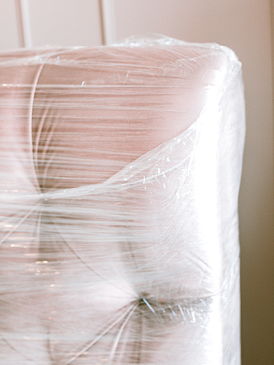 Wrap larger furniture items to protect against damage when moving house.