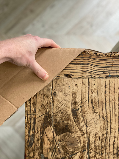 Use cardboard strips to protect corners of furniture when packing to move house.